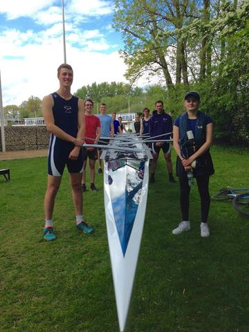 Students with newly refurbished rowing boat