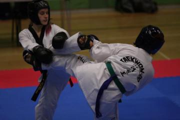 St Benet's student fighting Tae Kwon Do