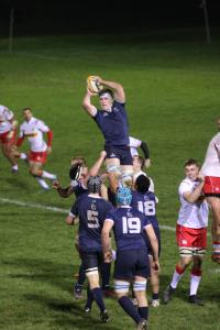 St Benet's student jumping for the ball; Men's Blues rugby vs Canada